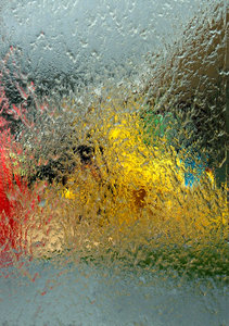 water textures: abstract colour and shape images seen through water running down glass windows