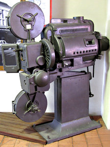 historic movie projector: old historic theatre movie projector