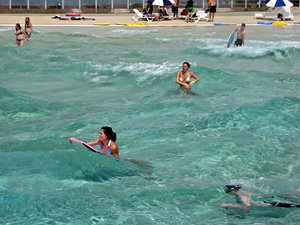 fun in the wave pool: people having fun in the wave pool