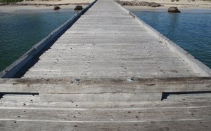 jetty's backward view: looking back along a wooden ocean front jetty