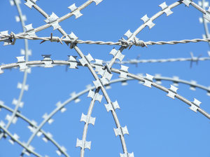 barbed and razor wire: razor wire  and barbed wire, barricade - security fence
