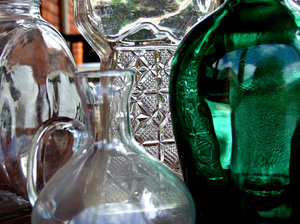 glass consideration: light reflections on glass bottles and jars - plain and coloured