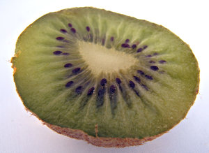 kiwi fruit: uncut and cut open ripe kiwi fruit - Actinidia Deliciosa