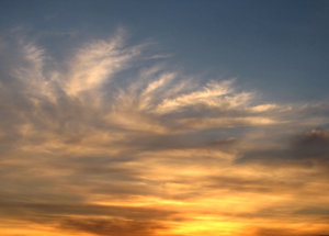 sunset skies: soft cloud formations at sunset