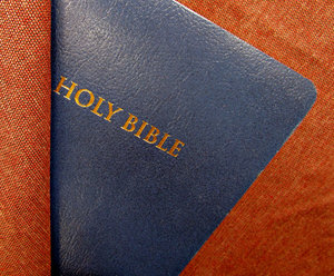 undercover blue Bible: partly covered blue Bible
