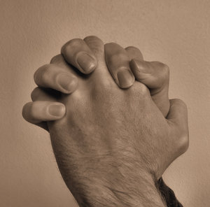 praying hands4: sepia image of man's hand as in prayer