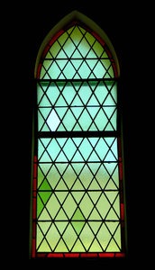 green diamonds: arched green stained glass window