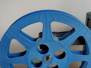 old movie time2: plastic 16mm movie reel on projector