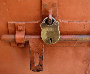 historic security1: old padlock on historic disused prison cell door