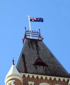 flag on high1: Australian flag on historic building tower