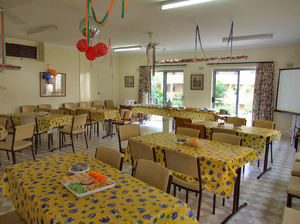 party preparation: community hall being prepared for senior's birthday party
