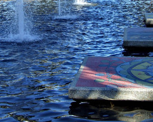 stirred & bubbling2: rippling water in fountain pond