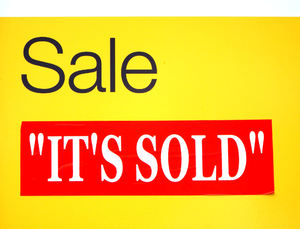 sold sale1: real estate sign indicating successful property sale