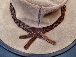 his winter hat1: man's suede leather winter hat - top back view with leather thonging
