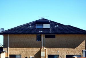 dark roof angles2: modern two-storey home roofing