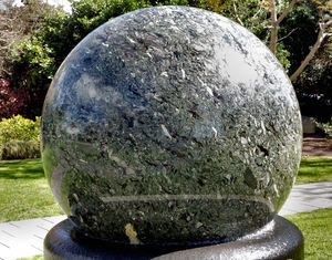 water rotating sphere1: 10 tonne kugel-ball of brecciated marble and granulitic schist floating on water on black granite base