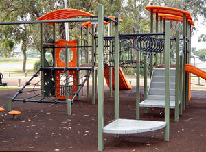 shaded playground equipment2: children's shaded playground equipment in suburban public park with background smoke haze