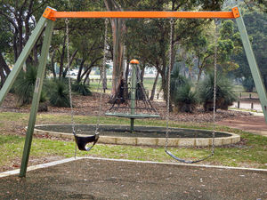 shaded playground equipment6: children's shaded playground equipment in suburban public park with background smoke haze