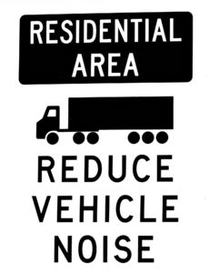 noise reduction warning: signage instructions for large trucks/semi trailers to reduce noise on entering town boundaries