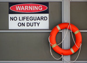 poolside warning1: warning sign & rescue device at sheltered facility swimming pool