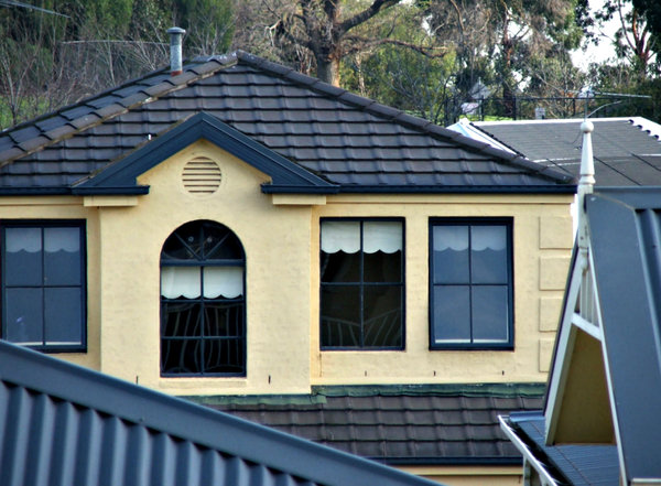 rooftops and angles: angles and surfaces of modern suburban roofing