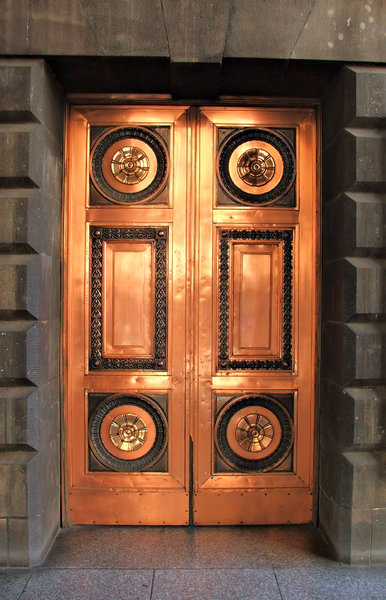 doors of bronze: polished bronze doors on old historic city building