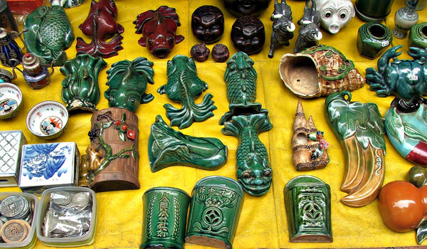 odds 'n' ends 'n' ornaments: variety of ornamental objects for sale at market stall
