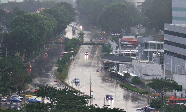 early evening rain: wet darkened road conditions in early evening rain