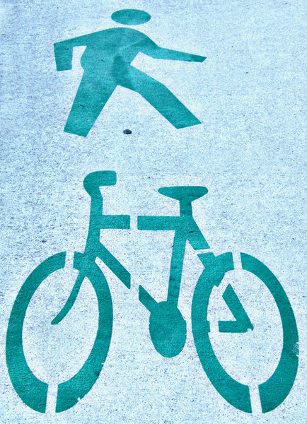pavement for 2: symbols illustrating pavement to be used by pedestrians and cyclists