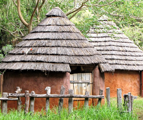 jungle huts,: thatched adobe style rondavels - round huts