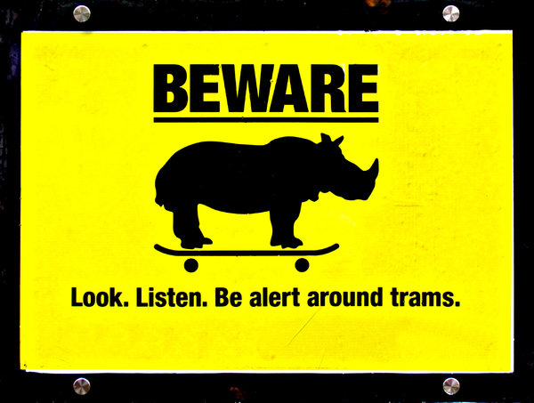 don't be a rhino: sign warning against unnecessary risks with trams