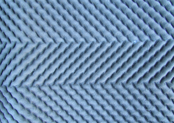 cushioned rubber underlay3: zig-zag ribbed rubbery carpet underlay