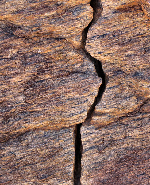 cracked solid4: large cracked solid rock surface