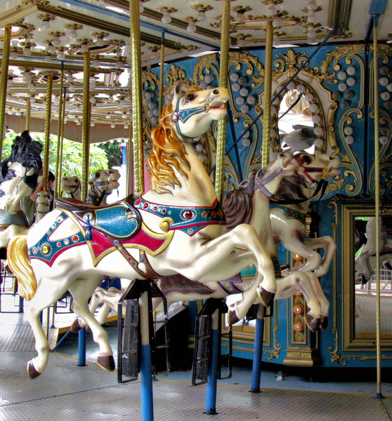 at the carousel2: a carnival's children's horse carousel - merry-go-round