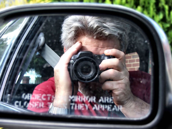 cameraman reflected2b: cameraman reflected in motor car mirror