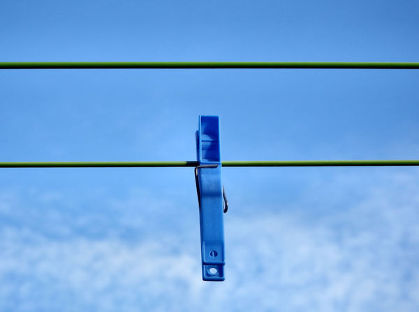 online alone1: single clothes peg on clothes line