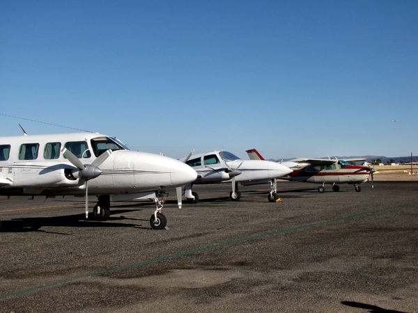 on the tarmac1: small planes on rural airport tarmac prior to take-off