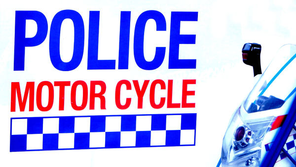 mobile boys in blue: sign promoting police motor bikes