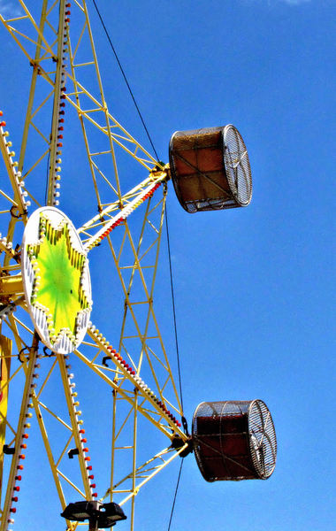 around in circles2b: colourful rotating fairground rides