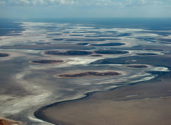 massive salt flats15: Lake Amadeus in the southwest corner of Australia's Northern Territory, is 180 km long and 10 km wide (70 miles long and about 8 miles wide)