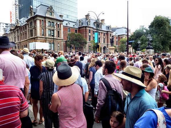 gathering crowd10: crowds of people gathering for street entertainment