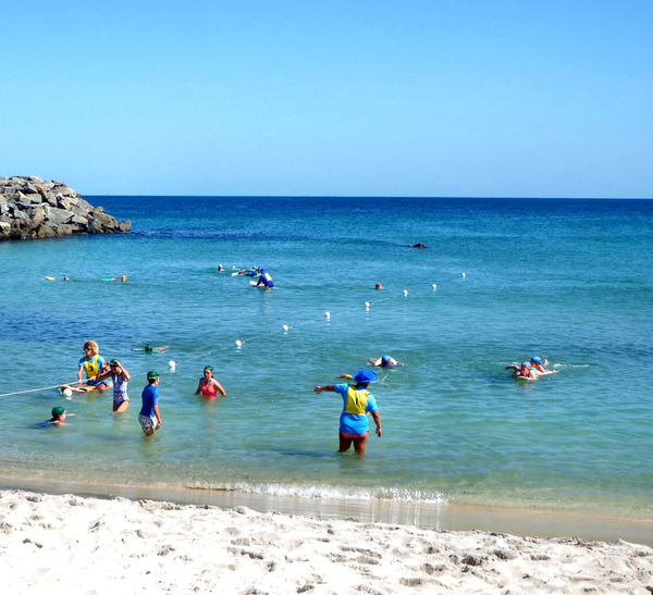 beachside relaxation4: people enjoying and relaxing at  Western Australian beach sand and sea