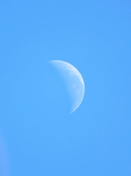 hint of distant moon: daytime view of partial moon visibility