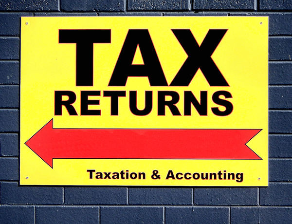 taxation optimism2: sign offering professional help to get something back from the taxation office/inland revenue