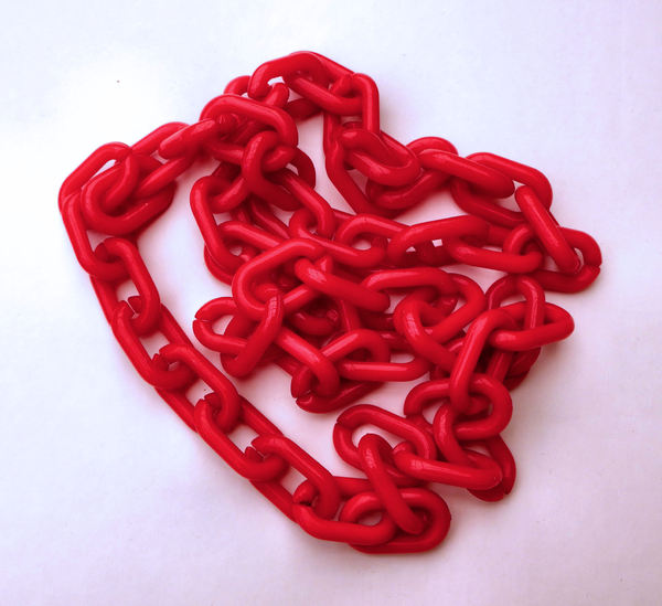 chained in red1: bunched up red plastic chain
