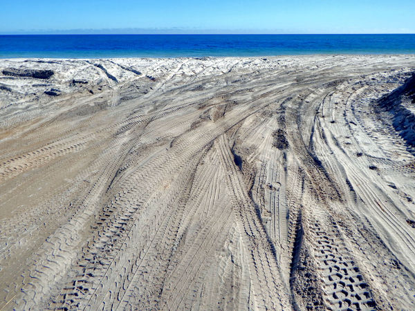4WD beach track damage1: damaging churned up beach tyre tracks