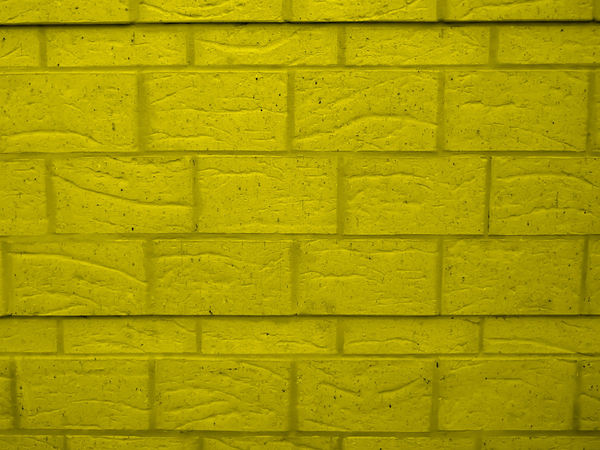 yellow brick wall1b: textures of yellow painted brick wall