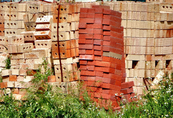 construction delay1: piled up bricks on abandoned building site