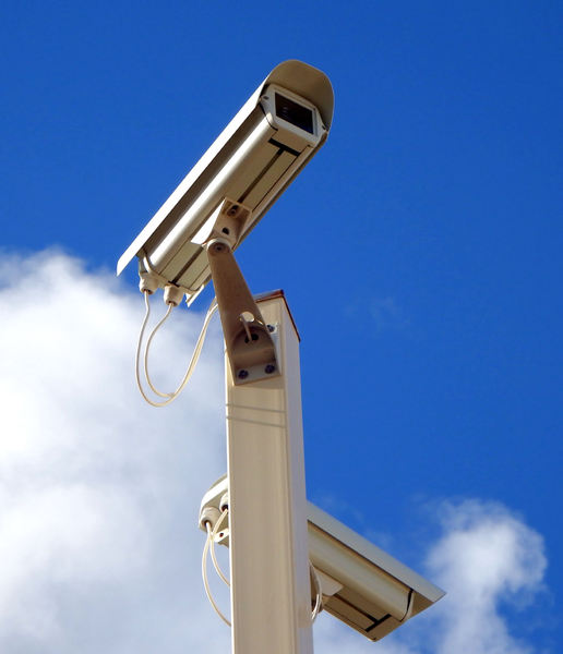 CCTV camera angles: high raised CCTV cameras on suburban hillside