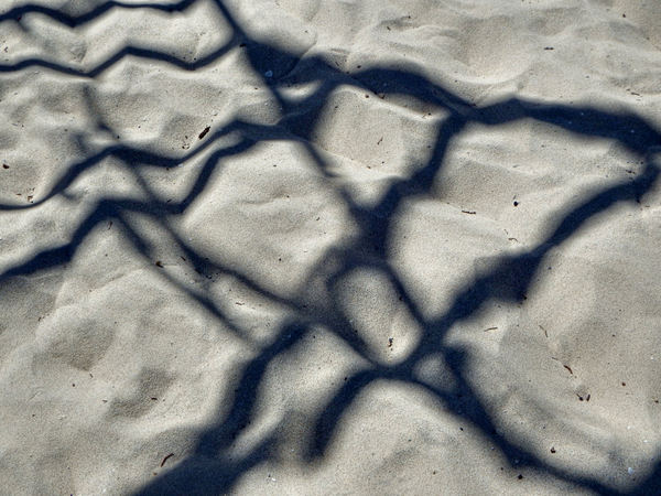 soft sand shadows1: abstract soft vague empty frame shadows on grainy sand